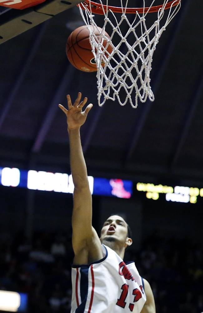 Mississippi forward Anthony Perez (13) shoots a layup over Florida in the second half of an NCAA college basketball game in Oxford, Miss., Saturday, Feb. 22, 2014. No. 2 Florida won 75-71
