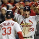 St. Louis Cardinals' David Freese, right, reacts as he and Daniel Descalso score on a single by Pete Kozma in the ninth inning of Game 5 of the National League division baseball series against the Washington Nationals early Saturday, Oct 13, 2012, in Washington. (AP Photo/Nick Wass)