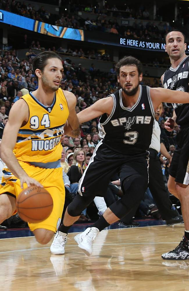From left to right, Denver Nuggets guard Evan Fournier, of France, works the ball inside as San Antonio Spurs guard Marco Belinelli, of Italy, covers while Spurs guard Manu Ginobili, of Argentina, and Nuggets forward Anthony Randolph look on in the first quarter of an NBA basketball game in Denver, Friday, March 28, 2014