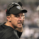 FILE - In this Nov. 28, 2013, file photo, Oakland Raiders head coach Dennis Allen coaches during the second half of an NFL football game against the Dallas Cowboys in Arlington, Texas. The Raiders fired Allen on Monday night, Sept. 29, 2014, after he lost the first four games of his third year as coach and often failed to field a competitive team. The decision was announced soon after the Raiders returned from London, where they lost their 10th straight game dating to last season, 34-14 to the Miami Dolphins on Sunday. (AP Photo/Brandon Wade, File)