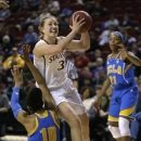 Stanford's Mikaela Ruef (3) shoots as UCLA's Kacy Swain (10) tumbles to the floor and Nirra Fields looks on during the first half of an NCAA college basketball game in the championship of the Pac-12 Conference tournament, Sunday, March 10, 2013, in Seattle. (AP Photo/Elaine Thompson)