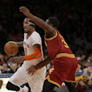 New York Knicks' J.R. Smith, left, moves past Cleveland Cavaliers' Dion Waiters during the first half of the NBA basketball game at Madison Square Garden, Sunday, March 23, 2014, in New York The Associated Press