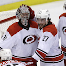 Carolina Hurricanes goalie Cam Ward is congratulated by defenseman Justin Faulk (27) after the Hurricanes' 2-1 win over the Detroit Red Wings in an NHL hockey game in Detroit, Friday, April 11, 2014 The Associated Press