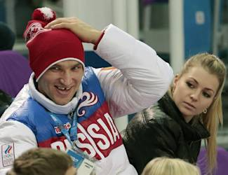 FILE - In this Tuesday, Feb. 11, 2014 file photo, Russian ice hockey player Alexander Ovechkin, left, and retired Russian tennis player Maria Kirilenko attend the pairs short program figure skating competition at the Iceberg Skating Palace during the 2014 Winter Olympics in Sochi, Russia. Russian tennis player Maria Kirilenko says she has broken off her planned wedding to Ovechkin of the Washington Capitals. The two had been together since 2011 and became engaged in December 2012. (AP Photo/Ivan Sekretarev, File)