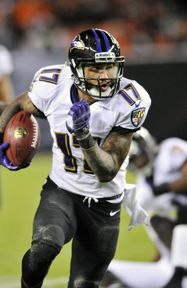 In this Nov. 3, 2013 file photo, Baltimore Ravens' Tandon Doss (17) returns a punt against the Cleveland Browns in the fourth quarter of an NFL football game in Cleveland. The Jacksonville Jaguars have signed free agent receiver Tandon Doss, giving the team a big target to complement Cecil Shorts III and Ace Sanders