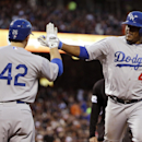 Los Angeles Dodgers' Juan Uribe, right, is high-fived by Adrian Gonzalez after Uribe's solo home run against the San Francisco Giants during the second inning of a baseball game on Tuesday, April 15, 2014, in San Francisco The Associated Press