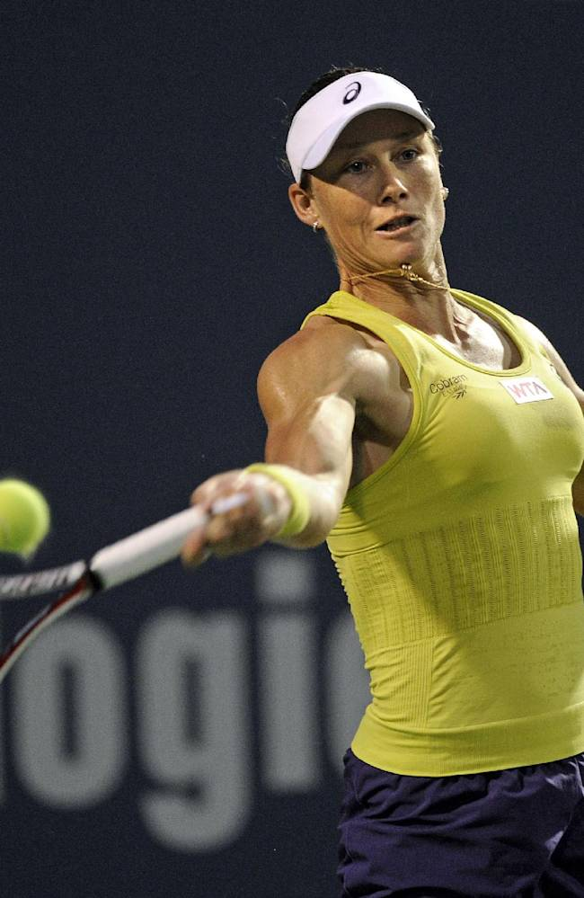 Samantha Stosur, of Australia, hits a forehand during a quarterfinal match against Kirsten Flipkens, of Belgium, at the New Haven Open tennis tournament in New Haven, Conn., on Thursday, Aug. 21, 2014