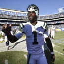 New York Jets quarterback Michael Vick (1) stands on the field after the San Diego Chargers defeated his team 31-0 in an NFL football game Sunday, Oct. 5, 2014, in San Diego The Associated Press