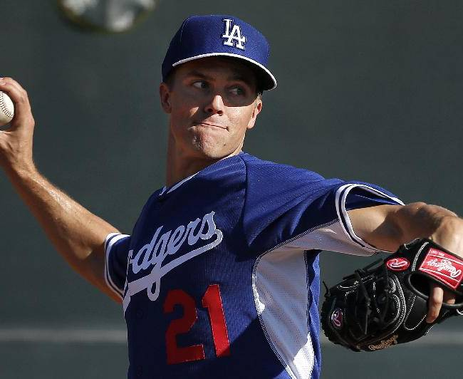 In this Monday, Feb. 10, 2014 file photo, Los Angeles Dodgers pitcher Zack Greinke throws during spring training baseball practice  in Glendale, Ariz. It wouldn't bother Zack Greinke if he didn't have to travel for the Los Angeles Dodgers; opener against Arizona in Australia.