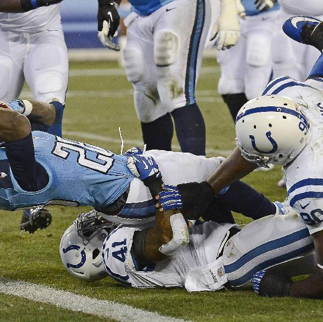 Tennessee Titans running back Chris Johnson (28) gets past Indianapolis Colts defenders Antoine Bethea (41) and Cory Redding (90) as Johnson scores a 7-yard touchdown in the first quarter of an NFL football game Thursday, Nov. 14, 2013, in Nashville, Tenn