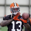 FILE - In this April 17, 2013, file photo, Cleveland Browns wide receiver Josh Gordon catches a pass during an NFL football practice in Berea, Ohio. Player representatives to the union voted to implement HGH testing for the 2014 NFL season, Friday, Sept. 12, 2014. Overall changes are retroactive for players who are suspended under previous policies, and for those in the appeal process. Those players, presumably including Browns receiver Josh Gordon, who is suspended for the season, and Broncos receiver Wes Welker (four games), would be subject to standards of the new policies. (AP Photo/Tony Dejak, File)