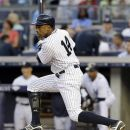 New York Yankees' Curtis Granderson (14) hits a second-inning, two-run single off Cleveland Indians starting pitcher Justin Masterson during their baseball game at Yankee Stadium in New York, Tuesday, June 26, 2012. (AP Photo/Kathy Willens)
