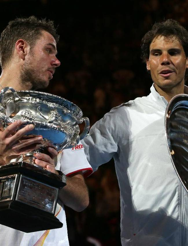 Stanislas Wawrinka of Switzerland, left,  talks with runner-up Rafael Nadal of Spain during the trophy presentation,  after his win in the men's singles final at the Australian Open tennis championship in Melbourne, Australia, Sunday, Jan. 26, 2014