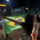 A demonstrator, holding a Brazilian flag, blocks a street during a small protest in Fortaleza, Brazil, Friday, June 21, 2013. Demonstrations began as an outcry against a 10-cent hike in bus and subway fares in Brazil's largest cities, but have continued even after announcements that the increases would be rescinded. Protesters have expressed frustration with corruption and what they say are high taxes and poor public services. They've demanded everything from education reforms to free bus fares while denouncing the billions of public dollars spent on stadiums before the World Cup and the Olympics. (AP Photo/Victor R. Caivano)