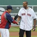 Jason Collins, the first active athlete to come out as being gay in one of the four U.S. major professional sports leagues, shakes hands with Boston Red Sox manager John Farrell after throwing out the ceremonial first pitch before a baseball game between the Boston Red Sox and the Texas Rangers at Fenway Park in Boston, Thursday, June 6, 2013. Collins played for six NBA teams in 12 seasons. He was dealt in a midseason trade from the Boston Celtics to the Washington Wizards and becomes a free agent July 1. (AP Photo/Charles Krupa)