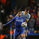 Chelsea's Eden Hazard, left, competes with Steaua Bucharest's Lukasz Szukala during their Champions League group E soccer match at Stamford Bridge, London, Wednesday, Dec. 11, 2013