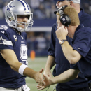 Dallas Cowboys head coach Jason Garrett congratulates quarterback Tony Romo (9) after a touchdown against the Oakland Raiders during the second half of an NFL football game, Thursday, Nov. 28, 2013, in Arlington, Texas The Associated Press