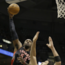 Toronto Raptors' Patrick Patterson (54) shoots against Milwaukee Bucks' ZaZa Pachulia during the first half of an NBA basketball game Saturday, April 5, 2014, in Milwaukee The Associated Press