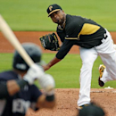 Pittsburgh Pirates starting pitcher Francisco Liriano, right, throws during the first inning of an exhibition spring training baseball game against the New York Yankees in Bradenton, Fla., Wednesday, Feb. 26, 2014 The Associated Press