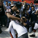 """FILE- In this Jan. 30, 2007, file photo, Ines Gomez Mont tries to pick up Chicago Bears safety Tyler Everett during media football day at Dolphin Stadium in Miami. More than 5,500 journalists, psuedo-journalists and other credentialed """"media"""" are expected to gather for Tuesday, Jan. 27, 2015, Media Day at the US Airways Center. (AP Photo/Mike Conroy, File)"""