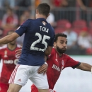 Toronto FC's Dwayne De Rosario, right, battles for the ball with Chivas USA's Donny Toia during the second half of an MLS soccer game in Toronto on Sunday, Sept. 21, 2014 The Associated Press
