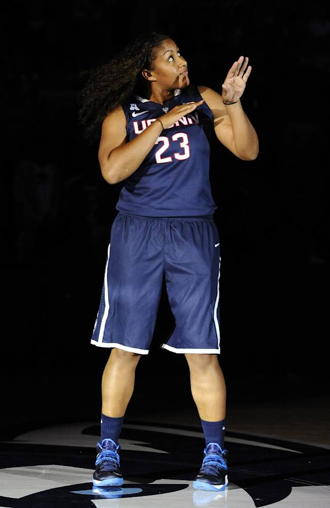 Connecticut's Kaleena Mosqueda-Lewis dances as she is introduced at the men's and women's basketball teams' First Night event, Friday, Oct. 18, 2013, in Storrs, Conn