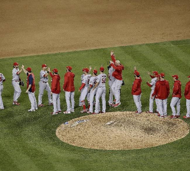 The St. Louis Cardinals celebrate after Game 4 of the National League baseball championship series against the Los Angeles Dodgers Tuesday, Oct. 15, 2013, in Los Angeles. The Cardinals won 4-2 to take a 3-1 lead in the series