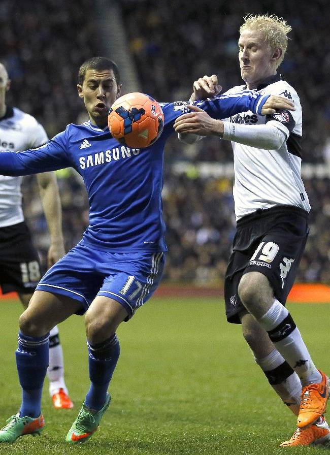 Chelsea's Eden Hazard, left, challenges for the ball with Derby's Will Hughes during the English FA Cup third round soccer match between Derby County and Chelsea at the iPro Stadium in Derby, England, Sunday, Jan. 5, 2014