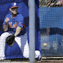 New York Mets pitcher Dillon Gee tries to stop a ball hit hard to him during a fielding drill at spring training baseball practice Wednesday, Feb. 19, 2014, in Port St. Lucie, Fla The Associated Press