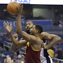 Cleveland Cavaliers' Tristan Thompson, front, goes up for a shot against Orlando Magic's Kyle O'Quinn during the first half of an NBA basketball game in Orlando, Fla., Wednesday, April 2, 2014 The Associated Press