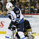Winnipeg Jets right winger Michael Frolik (67) deflects the puck against Buffalo Sabres goaltender Jhonas Enroth (1), of Sweden, during the second period of an NHL hockey game Wednesday, Nov. 26, 2014, in Buffalo, N.Y. Winnipeg won 2-1 The Associated Pres