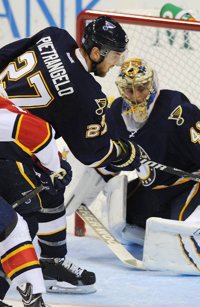 St. Louis Blues goalie Jaroslav Halak (41), of Slovkia, blocks a shot by Florida Panthers' Scottie Upshall, left, as Blues' Alex Pietrangelo (27) defends during the third period of an NHL hockey game Saturday, Oct. 5, 2013, in St. Louis