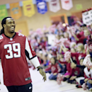 Atlanta Falcons' Steven Jackson is introduced to students at Shiloh Point Elementary School as part of the NFL's Play 60 Campaign to encourage kids to get 60 minutes of exercise a day, Tuesday, Dec. 3, 2013, in Cumming, Ga. Jackson addressed a special ass