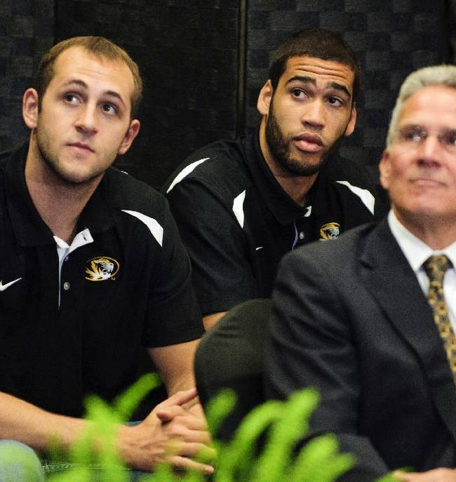 Missouri players, from left, Ryan Rosburg, Keanau Post and director of athletics Mike Alden listen as new Missouri men's basketball coach Kim Anderson speaks after he was introduced at an NCAA college basketball news conference in the Reynolds Alumni Center on Tuesday, April 29, 2014, in Columbia, Mo
