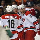 Carolina Hurricanes center Jordan Staal, right, celebrates his goal with Elias Lindholm, left, of Sweden, and Eric Staal during the third period of an NHL hockey game against the Anaheim Ducks, Tuesday, Feb. 3, 2015, in Anaheim, Calif. The Ducks won 5-4 i