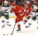 Detroit Red Wings center Darren Helm (43) skates while defended by Minnesota Wild defenseman Jonas Brodin (25) in the second period of an NHL hockey game in Detroit Tuesday, Jan. 20, 2015 The Associated Press