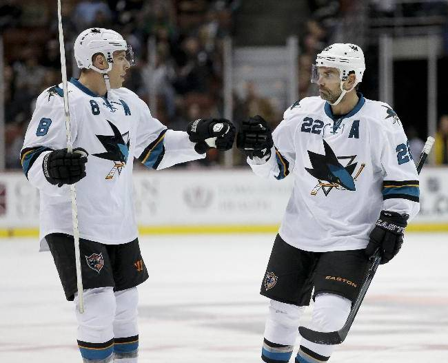 San Jose Sharks defenseman Dan Boyle, right, celebrates his goal with center Joe Pavelski during the third period of an NHL hockey preseason game against the Anaheim Ducks in Anaheim, Calif., Saturday, Sept. 28, 2013