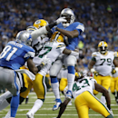 Detroit Lions running back Reggie Bush (21) is stopped by Green Bay Packers cornerback Sam Shields (37) during the second quarter of an NFL football game at Ford Field in Detroit, Thursday, Nov. 28, 2013 The Associated Press