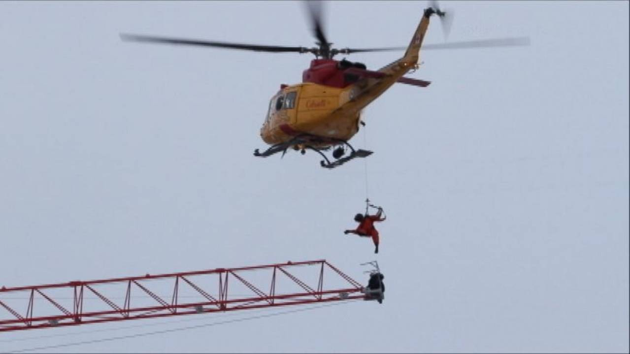 Harrowing Experience For a Crane Operator Clinging For His Life, Suspended Over...