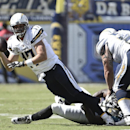 San Diego Chargers quarterback Philip Rivers is dragged down by Jacksonville Jaguars defensive end Ryan Davis while trying to release a pass during the second half of an NFL football game, Sunday, Sept. 28, 2014, in San Diego. The Associated Press