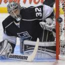 Los Angeles Kings goalie Jonathan Quick (32) deflects a shot during the third period against the San Jose Sharks in Game 5 of the Western Conference semifinals in the NHL hockey Stanley Cup playoffs, Thursday, May 23, 2013, in Los Angeles.  (AP Photo/Mark J. Terrill)