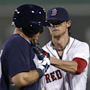Boston Red Sox starting pitcher Clay Buchholz tags out New York Yankees first baseman Mark Teixeira in the fourth inning of an exhibition baseball game in Fort Myers, Fla., Thursday, March 20, 2014 The Associated Press
