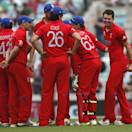 England's James Anderson, right, celebrates the wicket of South Africa's Colin Ingram by lbw with teammates during their ICC Champions Trophy semifinal cricket match at the Oval cricket ground in London, Wednesday, June 19, 2013. (AP Photo/Sang Tan)