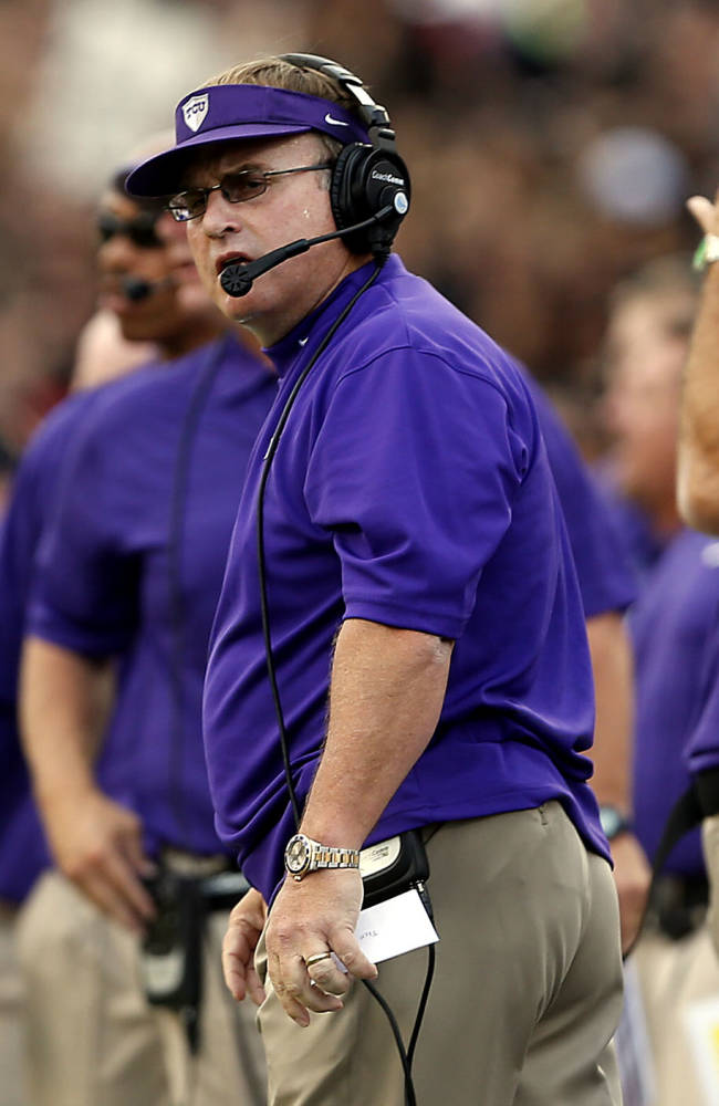 TCU's Gary Patterson watches as his team competes against Texas Tech during their NCAA college football game in Lubbock, Texas, Thursday, Sept. 12, 2013