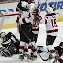New Jersey Devils right wing Dainius Zubrus (8), of Russia and left wing Patrik Elias (26), of Czech Republic celebrate a goal by Devils right wing Jaromir Jagr (68), of Czech Republic with Devils center Travis Zajac (19) as Anaheim Ducks goalie Jonas Hil