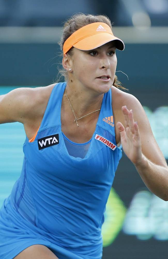 Belinda Bencic, of Switzerland, runs to the ball against Sara Errani, of Italy, during the Family Circle Cup tennis tournament in Charleston, S.C., Friday, April 4, 2014