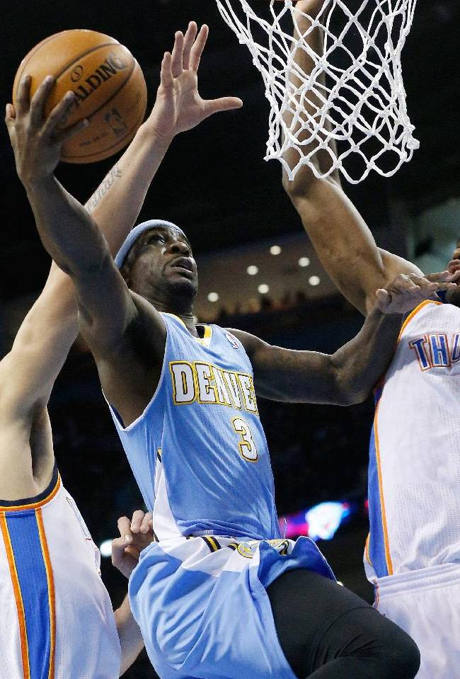 Denver Nuggets guard Ty Lawson (3) is fouled by Oklahoma City Thunder center Steven Adams as he shoots between Adams and forward Serge Ibaka (9) in the first quarter of an NBA basketball game in Oklahoma City, Monday, Nov. 18, 2013
