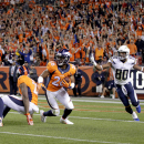 Denver Broncos free safety Rahim Moore (26) intercepts a pass intended for San Diego Chargers wide receiver Malcom Floyd (80) as Broncos' Aqib Talib gets up during the second half of an NFL football game, Thursday, Oct. 23, 2014, in Denver. The Broncos wo