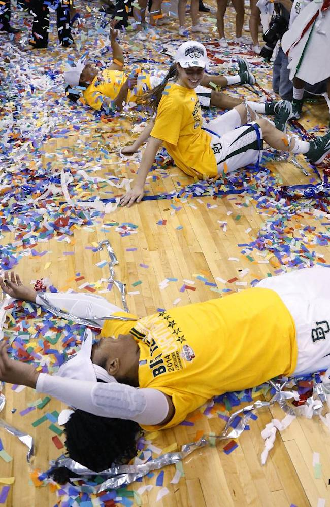 From top, Baylor point Mariah Chandler (11), guard Makenzie Robertson (14) and guard Odyssey Sims (0) make snow angels in the confetti following an NCAA college basketball game against West Virginia in the finals of the Big 12 Conference women's college tournament in Oklahoma City, Monday, March 10, 2014. Baylor won 74-71