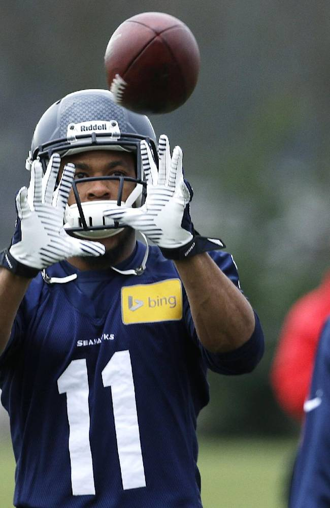 Seattle Seahawks wide receiver Percy Harvin catches a ball tossed to him during stretching warmups, Thursday, Jan. 2, 2014, before NFL football practice in Renton, Wash